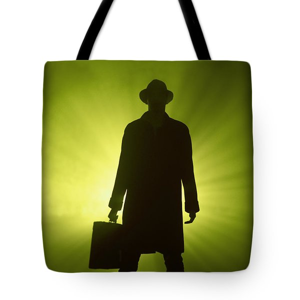 Tote Bag featuring the photograph Man With Case In Green Light by Lee Avison