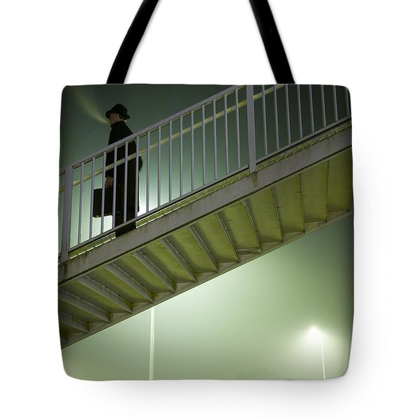 Tote Bag featuring the photograph Man With Case On Steps Nighttime by Lee Avison