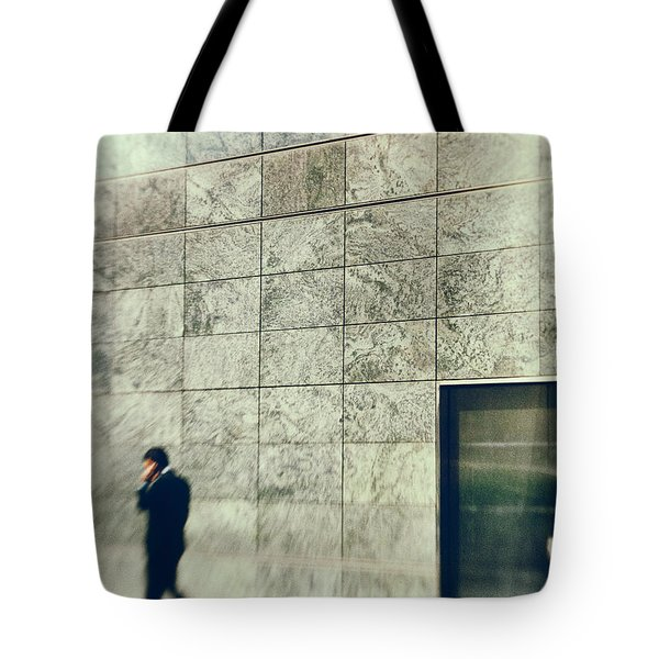 Tote Bag featuring the photograph Man With Cell Phone by Silvia Ganora