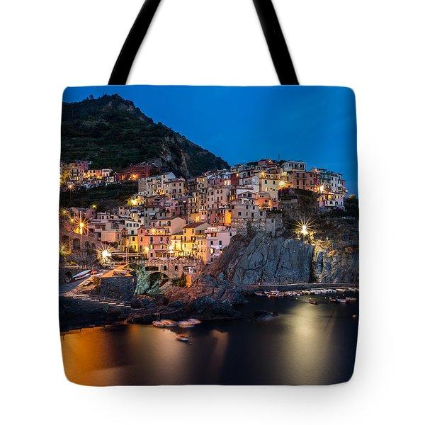 Tote Bag featuring the photograph Manarola by Mihai Andritoiu