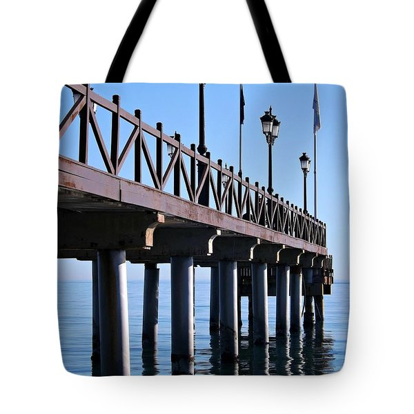 Tote Bag featuring the photograph Marbella Pier Spain by Clare Bevan