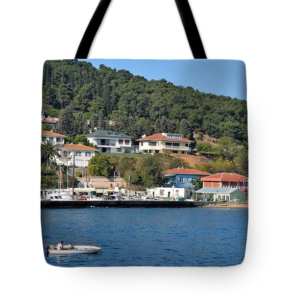 Marina Bay Scene With Boat And Houses On Hills Tote Bag by Imran Ahmed