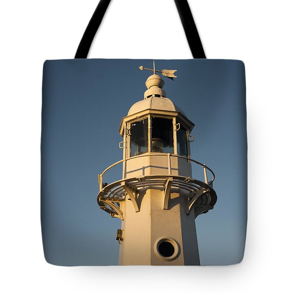 Mevagissey Lighthouse In The Evening Tote Bag by Anne Gilbert