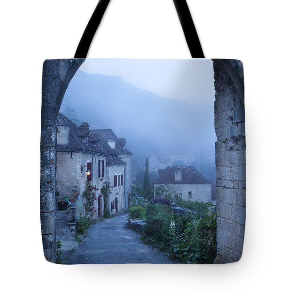 Misty Dawn In Saint Cirq Lapopie Tote Bag by Brian Jannsen