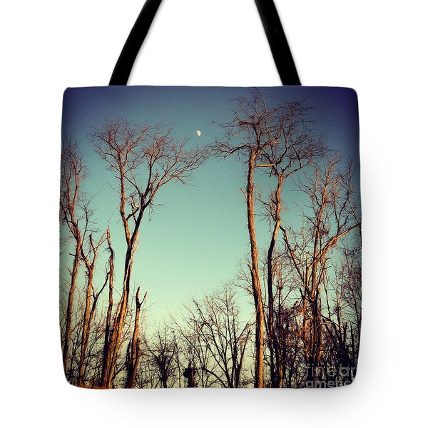 Tote Bag featuring the photograph Moon Between The Trees by Kerri Farley