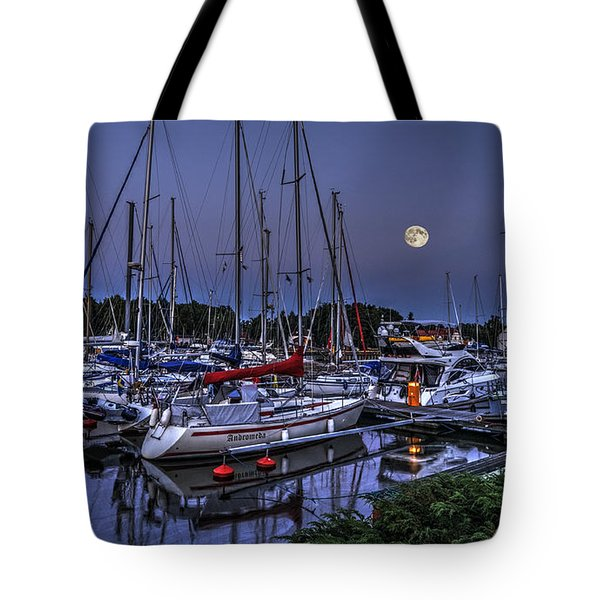 Tote Bag featuring the photograph Moonlight Over Yacht Marina In Leba In Poland by Julis Simo