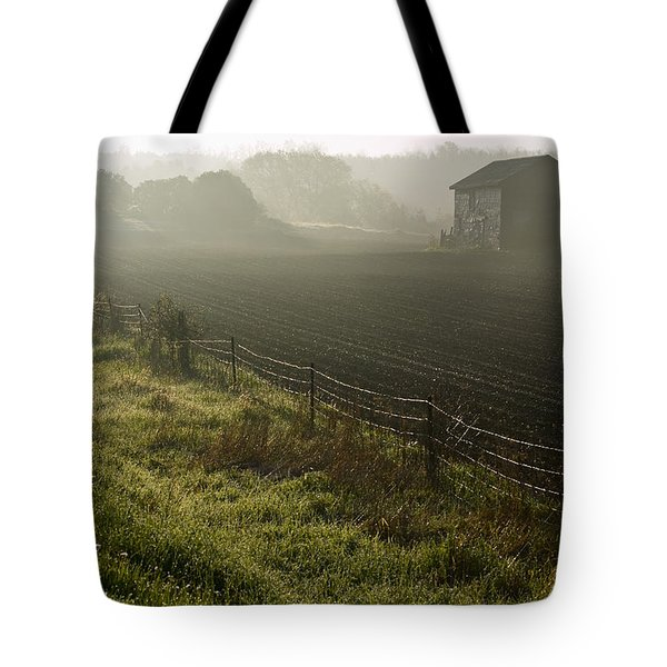 Morning Mist Over Field And Tote Bag by Jim Craigmyle