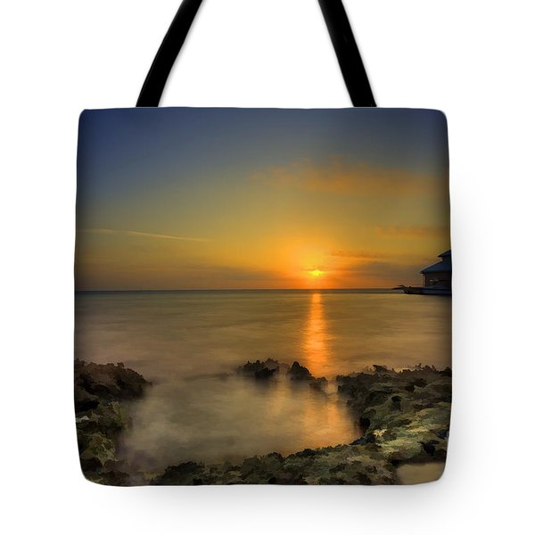 Morning Sun Rising In The Grand Caymans Tote Bag by Dan Friend
