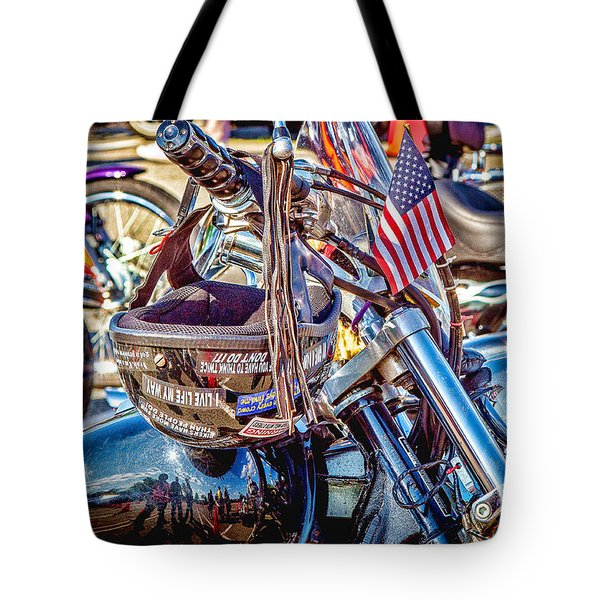 Tote Bag featuring the photograph Motorcycle Helmet And Flag by Eleanor Abramson