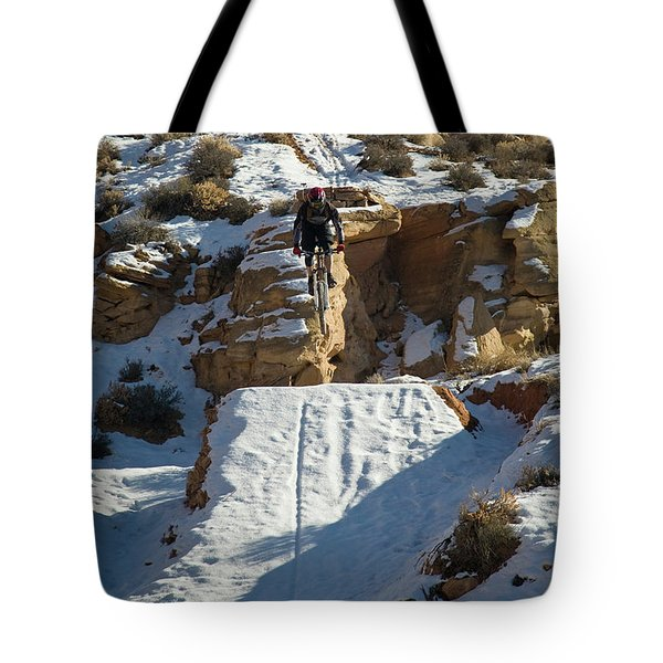 Mountain Biker Jumping With Snowy Tote Bag