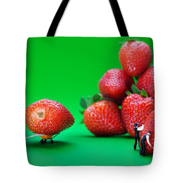 Tote Bag featuring the photograph Moving Strawberries To Depict Friction Food Physics by Paul Ge
