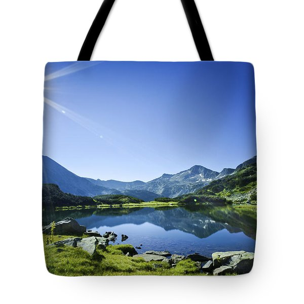 Muratov Lake Against Blue Sky Tote Bag by Evgeny Kuklev