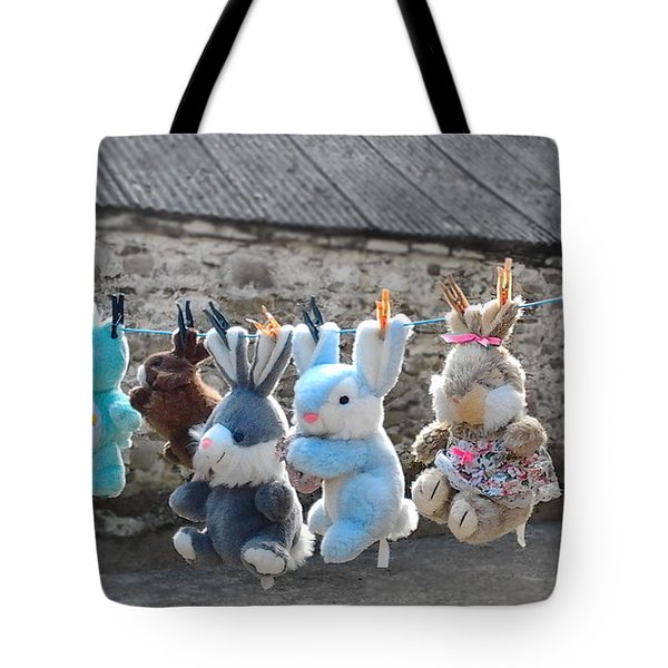 Tote Bag featuring the photograph Toys On Washing Line by Nina Ficur Feenan
