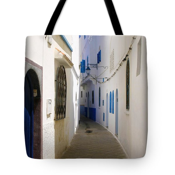 Tote Bag featuring the photograph Narrow Backstreet In The Medina Of Asilah On Northwest Tip Of Atlantic Coast Of Morocco by Ralph A  Ledergerber-Photography
