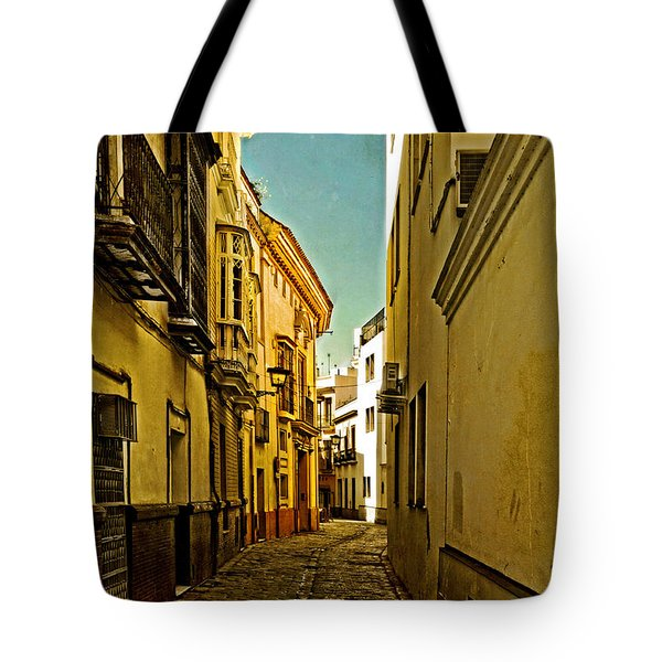 Narrow Street In Seville Tote Bag by Mary Machare