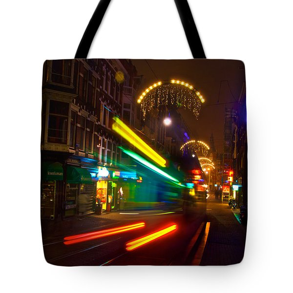 Tote Bag featuring the photograph Neon Tram Leidestraat by Jonah  Anderson