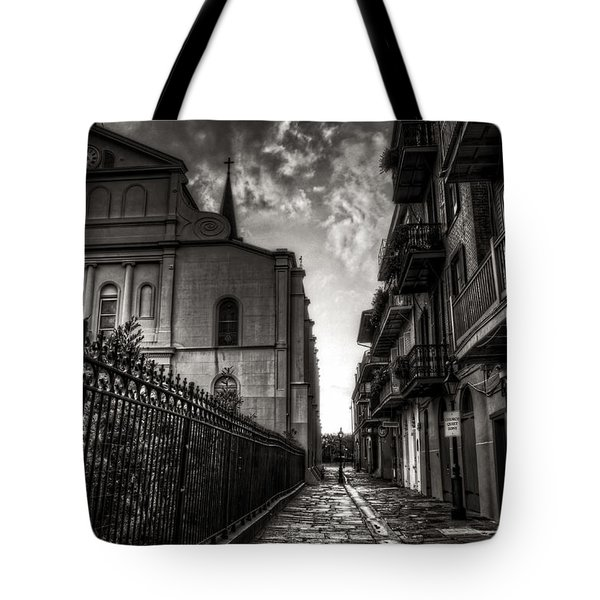 Tote Bag featuring the photograph New Orleans' Pirates Alley In Black And White by Greg and Chrystal Mimbs