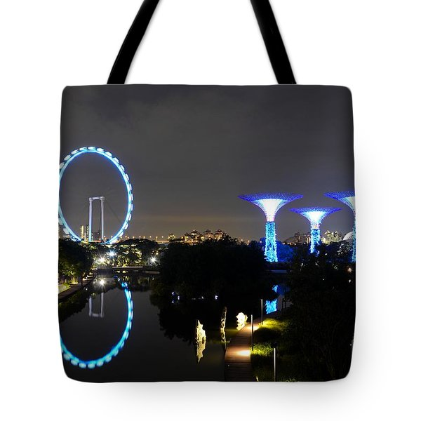 Night Shot Of Singapore Flyer Gardens By The Bay And Water Reflections Tote Bag