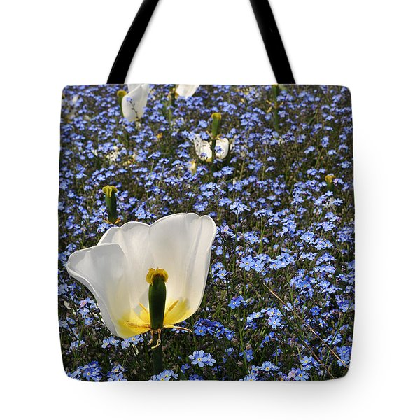 Tote Bag featuring the photograph No More Tulips by Simona Ghidini