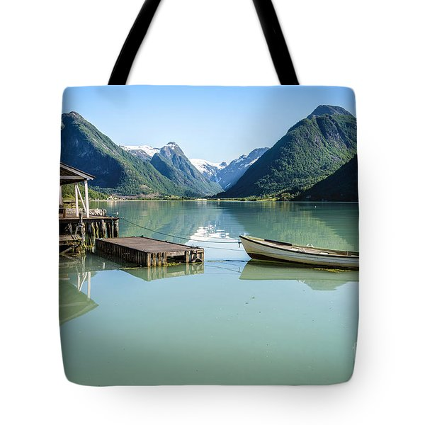 Reflection Of A Boat And A Boathouse In A Fjord In Norway Tote Bag