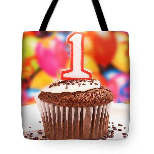Tote Bag featuring the photograph Chocolate Cupcake With One Burning Candle by Vizual Studio