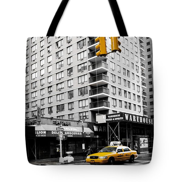 Nyc  Yellow Cab At The Crossroad Tote Bag by Hannes Cmarits