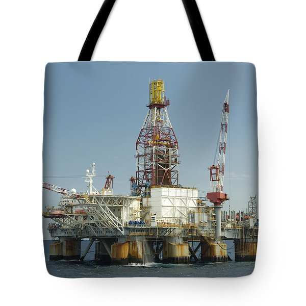 Tote Bag featuring the photograph Ocean Oil Rig by Bradford Martin