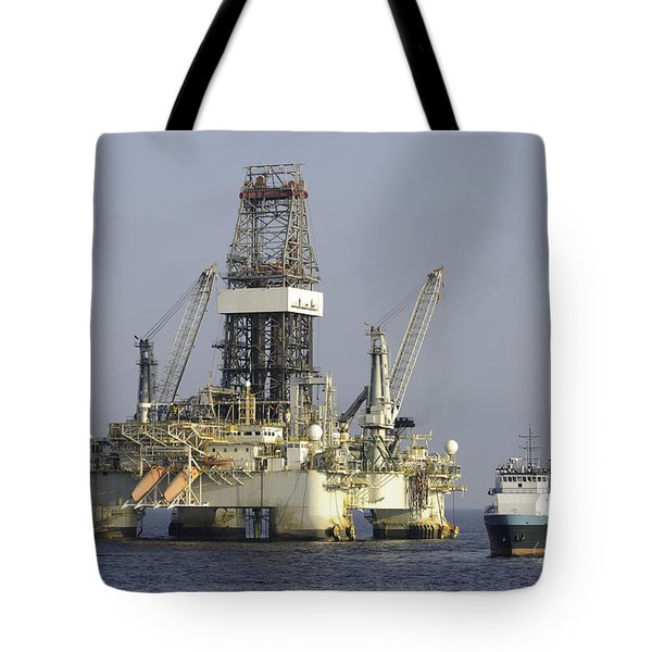 Tote Bag featuring the photograph Ocean Oil Rig With Supply Boat by Bradford Martin