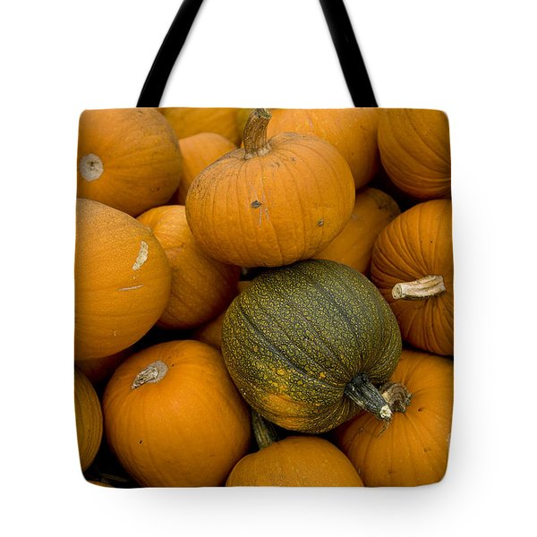 Tote Bag featuring the photograph Odd One Out by David Millenheft