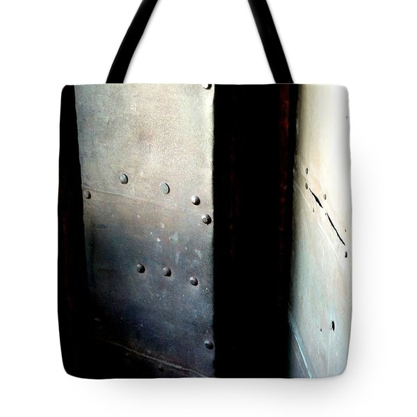 Tote Bag featuring the photograph Of Shadow And Intent by Newel Hunter