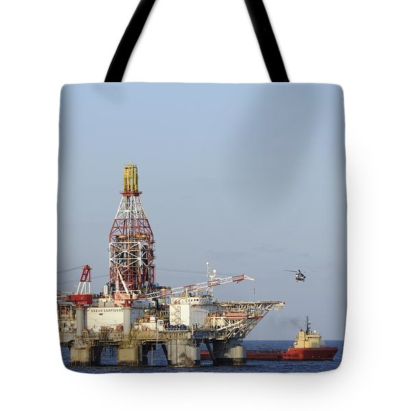 Off Shore Oil Rig With Helicopter And Boat Tote Bag