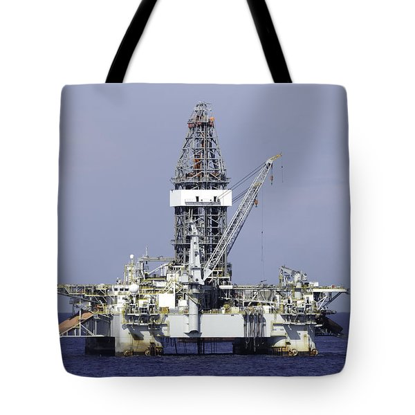 Tote Bag featuring the photograph Offshore Oil Rig In Blue Ocean by Bradford Martin