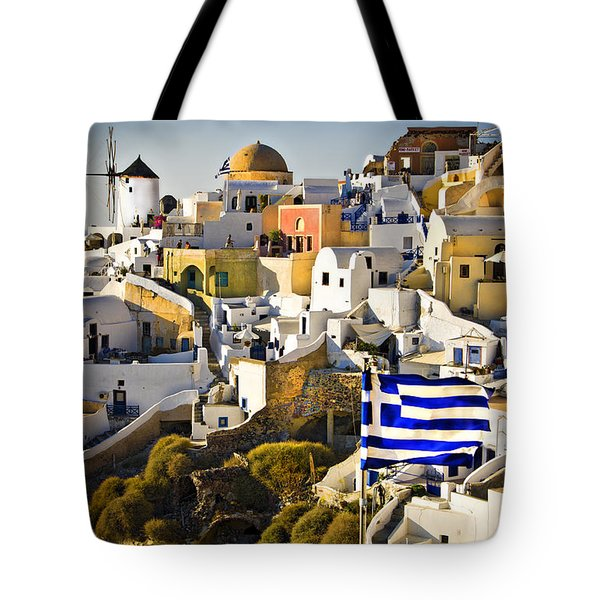 Tote Bag featuring the photograph Oia And A Greek Flag by Meirion Matthias