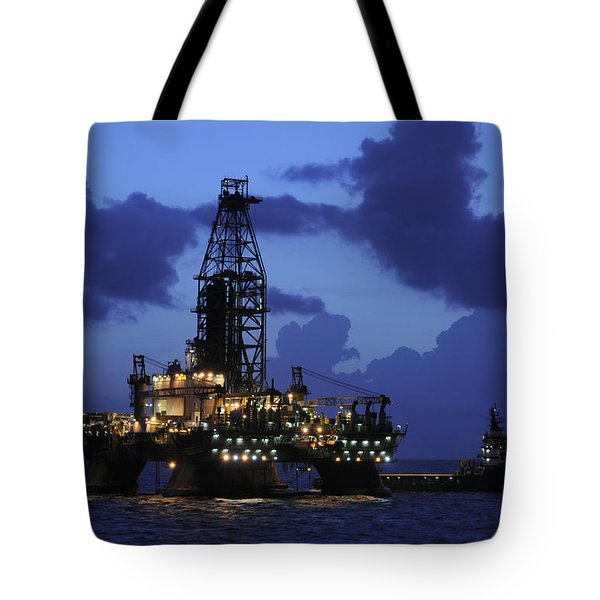 Tote Bag featuring the photograph Oil Rig And Vessel At Night by Bradford Martin
