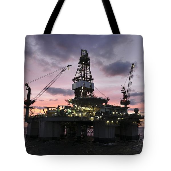 Tote Bag featuring the photograph Oil Rig At Dawn by Bradford Martin