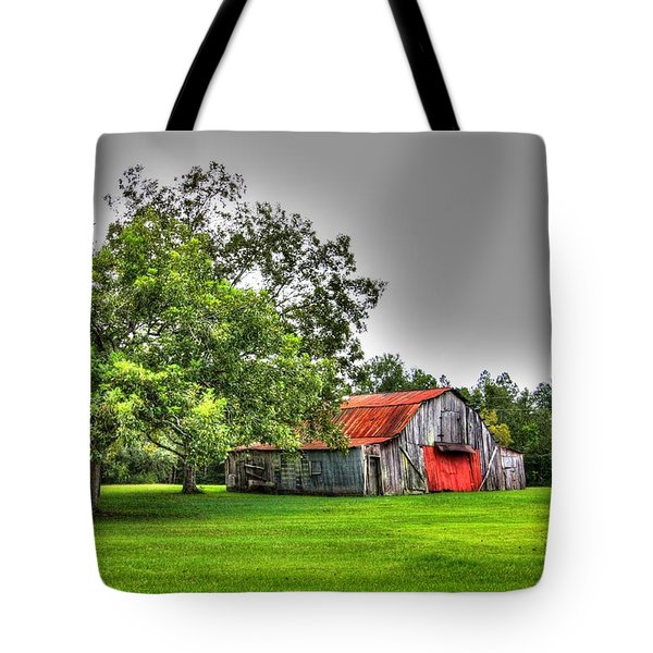 Tote Bag featuring the photograph Old Barn With Red Door by Lanita Williams