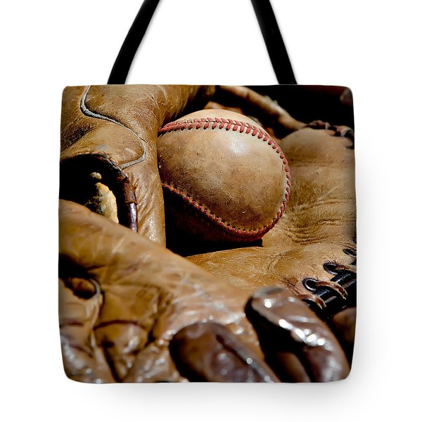 Tote Bag featuring the photograph Old Baseball Ball And Gloves by Art Block Collections