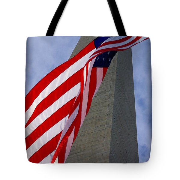Tote Bag featuring the photograph Old Glory And The Washington Monument by John S