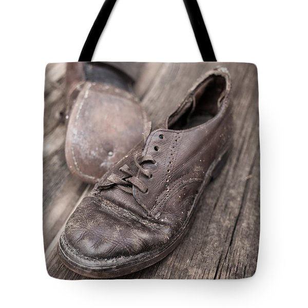 Old Leather Shoes On Wooden Floor Tote Bag by Edward Fielding