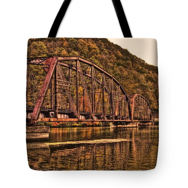 Tote Bag featuring the photograph Old Railroad Bridge With Sepia Tones by Jonny D