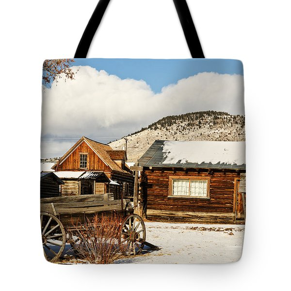 Tote Bag featuring the photograph Old Wagon And Ghost Town Buildings by Sue Smith