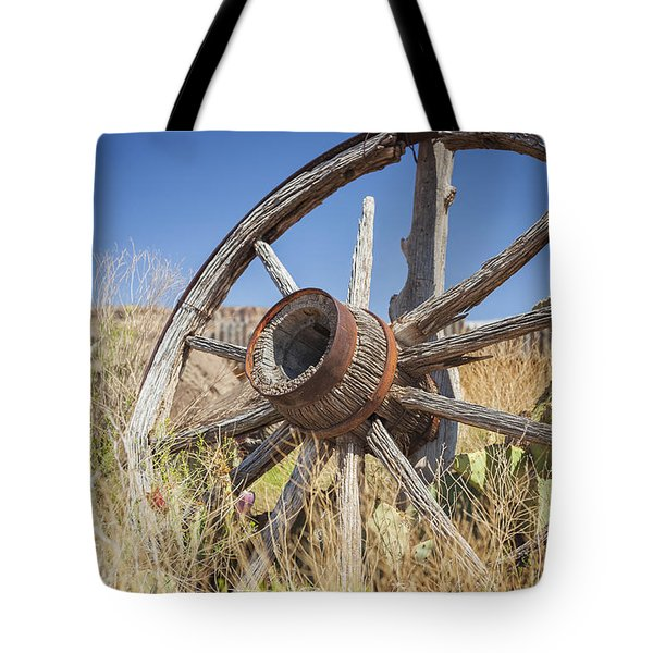 Tote Bag featuring the photograph Old Wagon Wheel by Bryan Mullennix