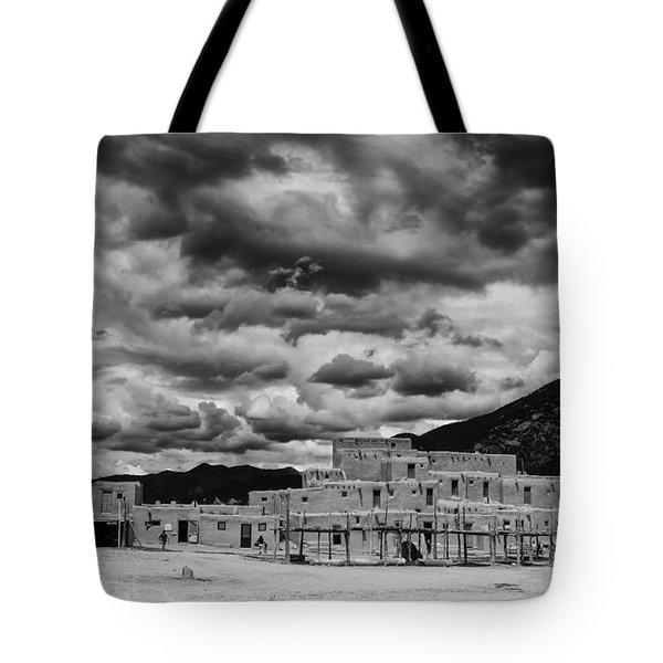 Ominous Clouds Over Taos Pueblo Tote Bag