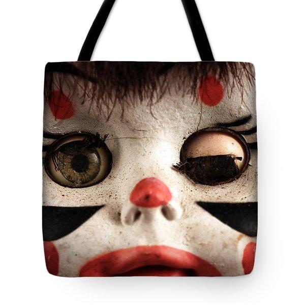 Tote Bag featuring the photograph One Eye Shut by John Rizzuto