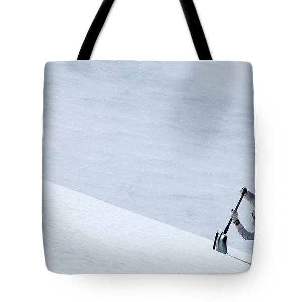 One Man Digging A Pit In The Snow Tote Bag