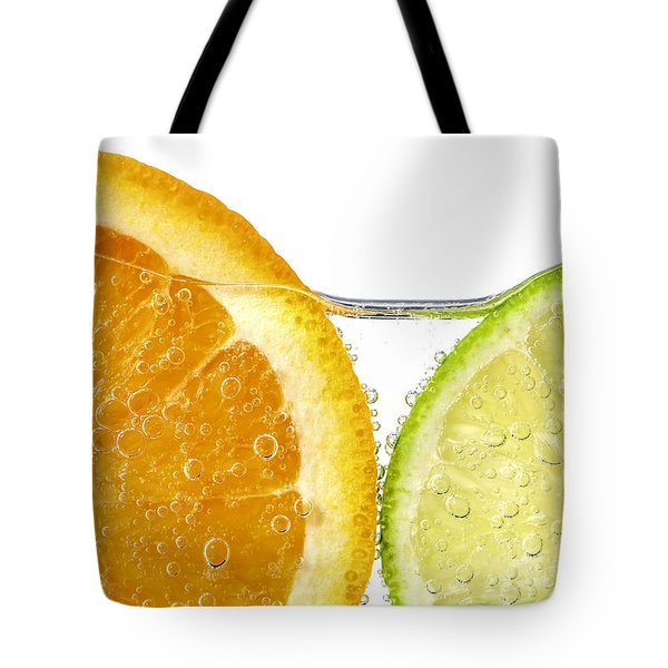 Orange And Lime Slices In Water Tote Bag by Elena Elisseeva