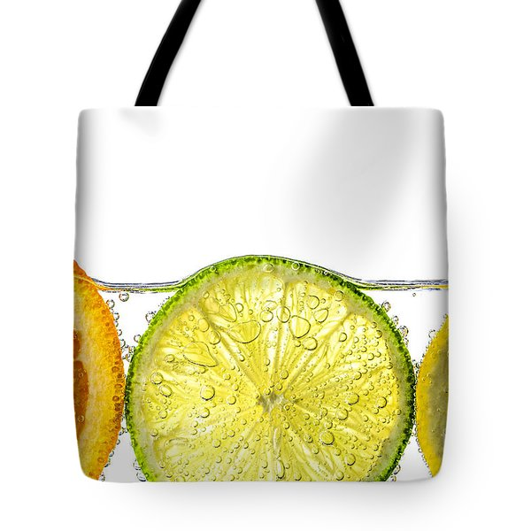 Orange Lemon And Lime Slices In Water Tote Bag by Elena Elisseeva