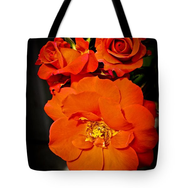 Tote Bag featuring the photograph Orange Rose Trio by Joann Copeland-Paul
