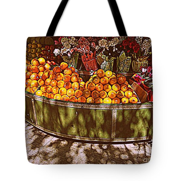 Tote Bag featuring the photograph Oranges And Flowers by Miriam Danar
