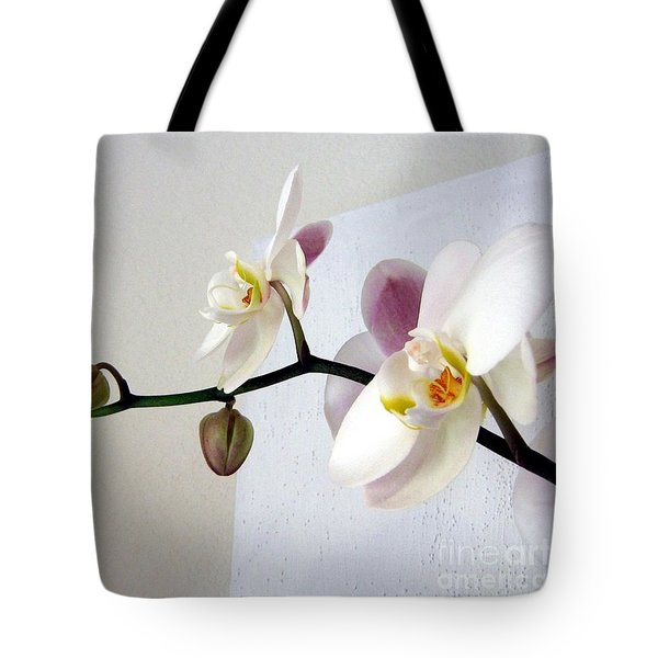 Tote Bag featuring the photograph Orchid Coming Out Of Painting by Barbara Yearty